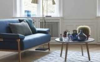 Синий диван в интерьере: в каких стилях уместен?